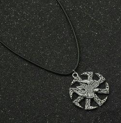 Slavic amulet of the sun (Kolovrat) with a falcon