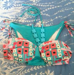 Swimsuit with beads used.