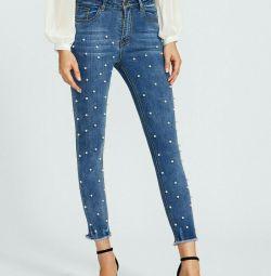 джинси з намистинами