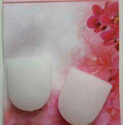 Напальчники, белого цвета