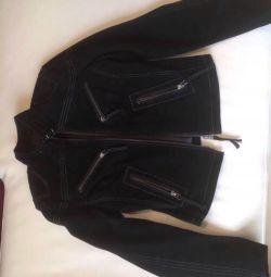 Jacket female suede. natural? Black color.
