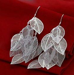 Silver earrings. New