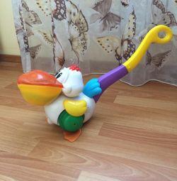 Каталка пеликан затейник музыкальный