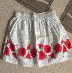 Fuste și pantaloni scurți pentru o fată