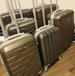 Three sizes of Berger suitcases. Delivery is free