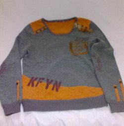 Gray sweater with orange inserts.