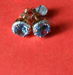 Gold pusetas with topaz and diamonds.