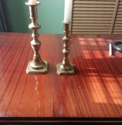 Candlestick brass church with adjustment of a candle