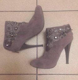 Ankle boots suede with a beautiful decor
