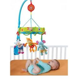 Taf Toys Jungle mobile for children on the bed