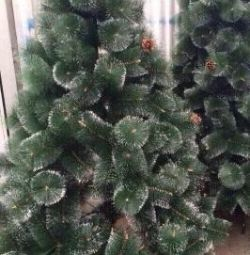 Artificial Christmas trees with snowy needles