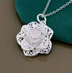 Pendant on a chain. Silver is new.
