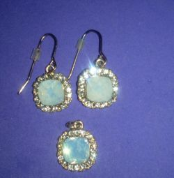 Set of jewelry earrings and pendant