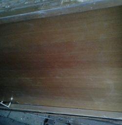 The door is wooden.