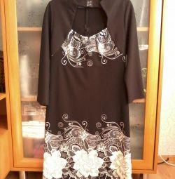 нове плаття, 44-46 р., по спинці блискавка