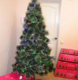 Artificial Christmas tree with a garland