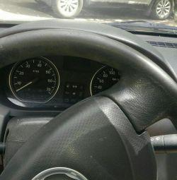 водій