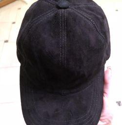 Men's cap is natural suede. A discount.