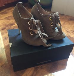 Interesting heel ankle boots