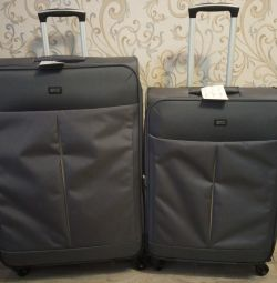 New fabric suitcases are very large and medium