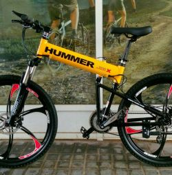 Yellow bicycle Hummer on black cast wheels