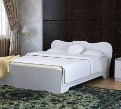Bed with a curly back