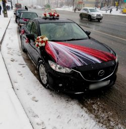 Rent a red decoration for a wedding car