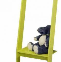 Hanging clothes for children with a shelf