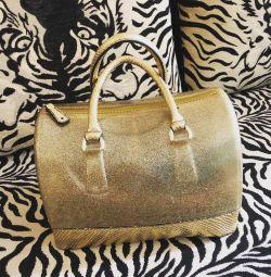 Altın lastik çanta