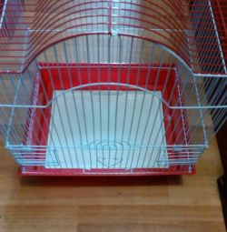 A cage for birds. New! White with red!