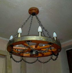 Chandelier from the wheel, from the cart. Handwork