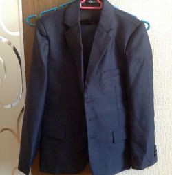 A new school suit for a boy of 6-8 years.