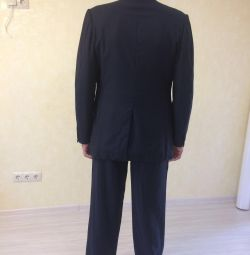 Men's suit is dark blue