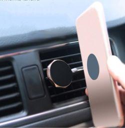 Suport pentru telefoane mobile în deflector