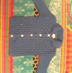 A new baby warm knitted sweater. 68 size.