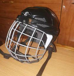 Protective hockey helmet.
