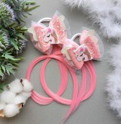 Bows with strands of hair