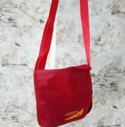 A new bag, over your shoulder.
