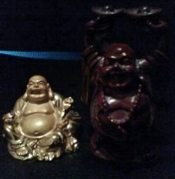 2 статуетки золота і тeмно-бардовая