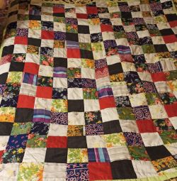 Quilt, pillowcases in the style of patchwork.