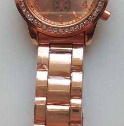 "Golden watches on a golden ""Geneva"" bracelet."