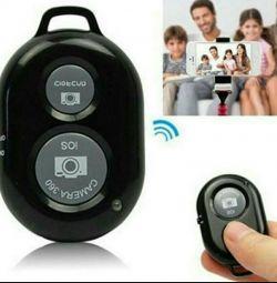 Telecomanda Bluetooth pentru selfie de la telefon.