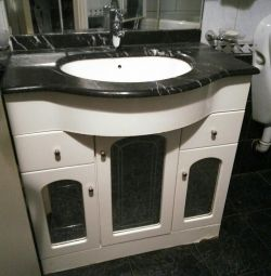 Cabinet with sink and mirror