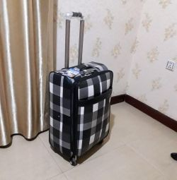 A suitcase with 3 divisions. New.