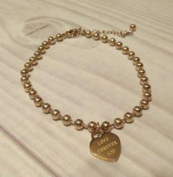 Золотистий браслет з серцем