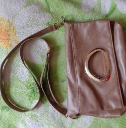 Handbag with a long strap