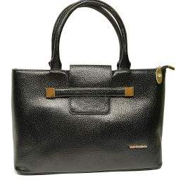 Women's bag is black. Eco leather.