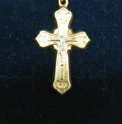 Gold pendant in the form of a cross