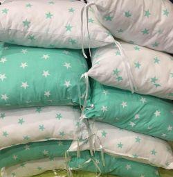 Cushion tops in the crib