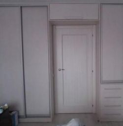 Sliding wardrobe around the doorway